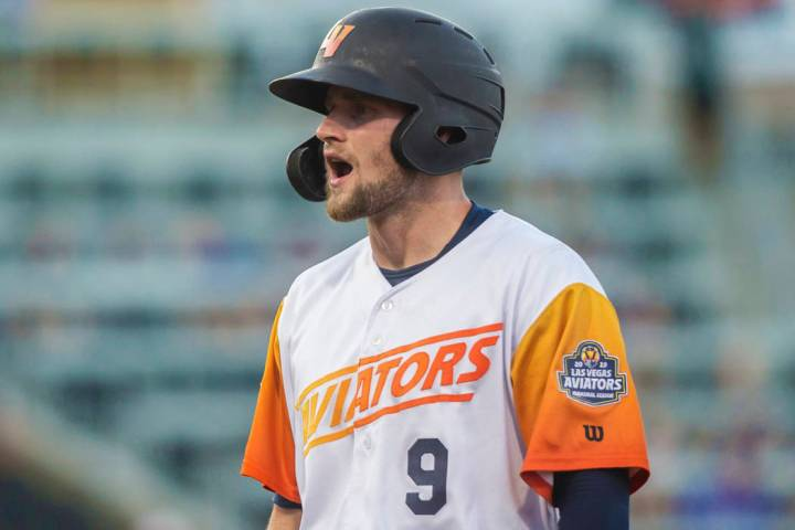 Las Vegas Aviators first baseman Seth Brown (9) pumps up his teammates after singling in the bo ...