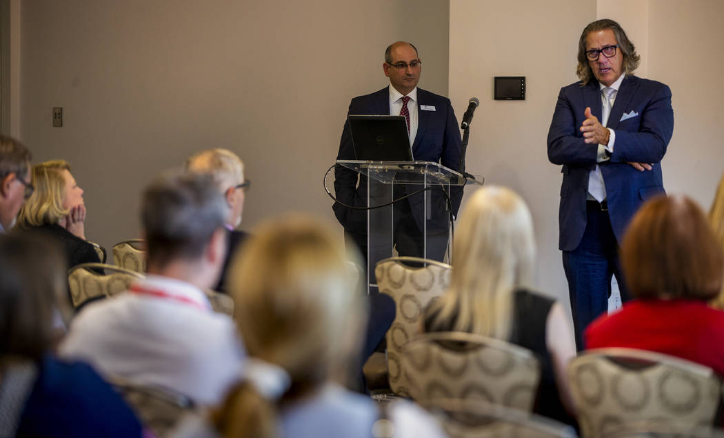 CEO Bob Maricich with the International Market Centers, right, speaks during a press conference ...