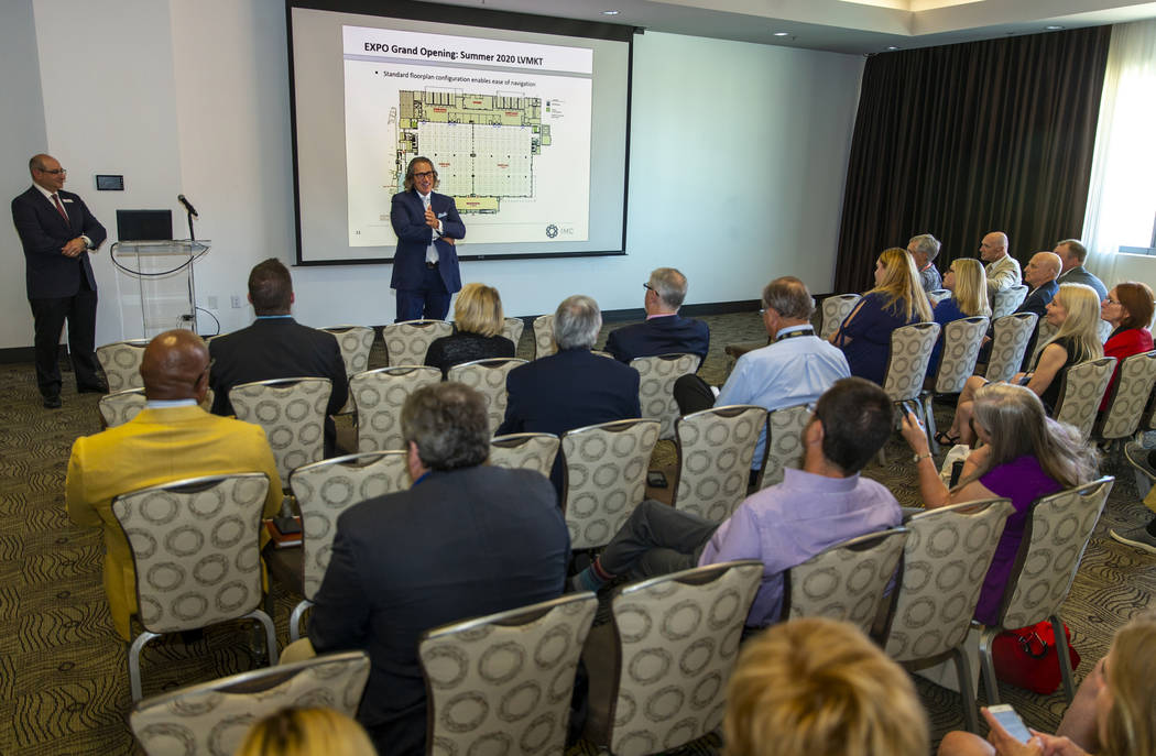 CEO Bob Maricich with the International Market Centers, center, speaks during a press conferenc ...