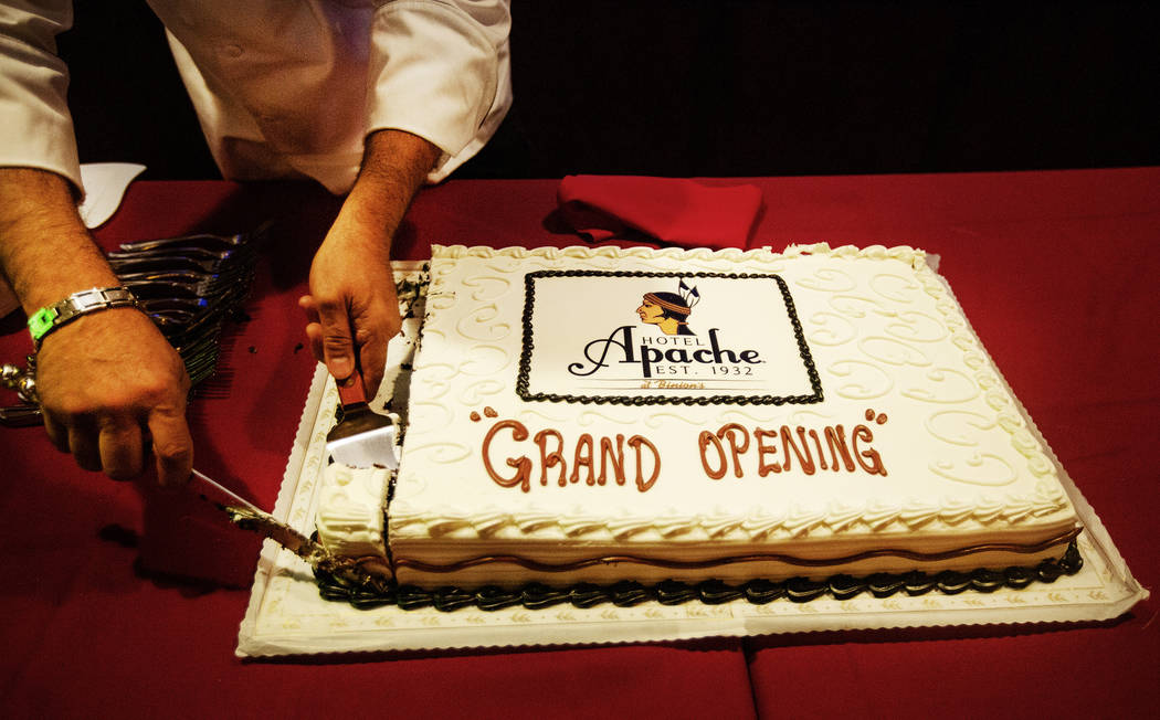 A piece of cake is cut celebrating the grand opening of the Hotel Apache at Binion's on July 2 ...