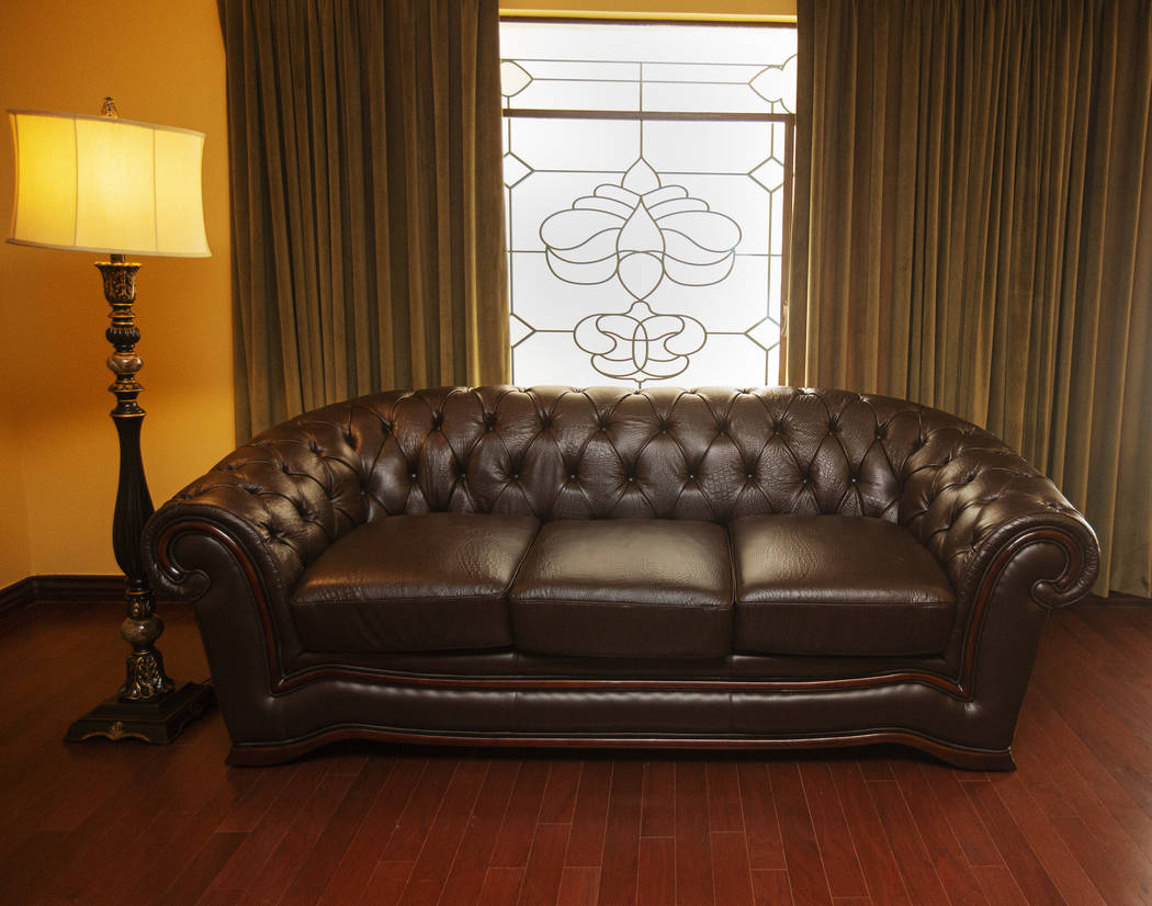 A remodeled lamp and couch of a guest room of the historic Hotel Apache at Binion's Gambling Ha ...