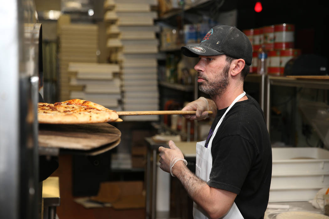 Will Stander prepares a grasshopper pizza at Evel Pie in Las Vegas, Tuesday, July 30, 2019. (Er ...