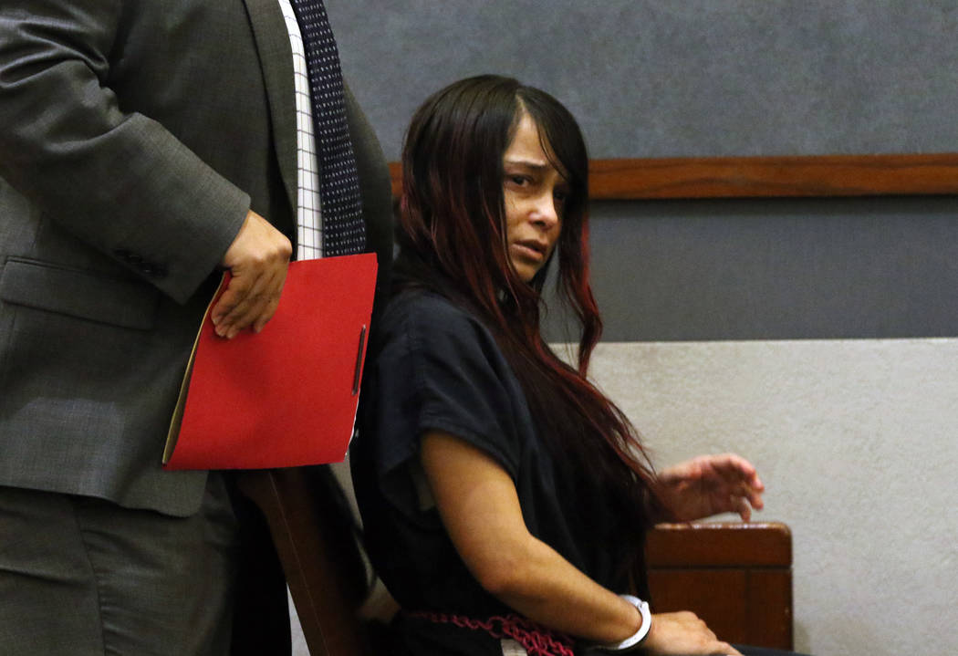 Gigi Mitchell, accused of trafficking an 11-year-old girl, appears in court with her defense at ...