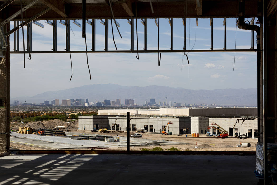 A view of the Las Vegas Strip is seen at the Raiders' headquarters construction site in Henders ...