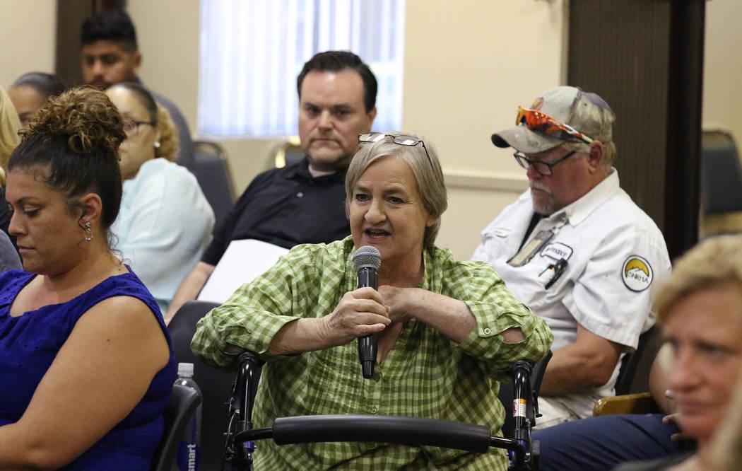 Southern Nevada Regional Housing Authority (SNRHA) employee, Martha Floyd, speaks during the SN ...