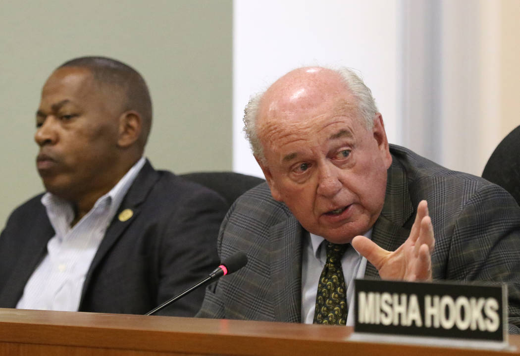 Southern Nevada Regional Housing Authority Commissioner Lawrence Weekly, left, listens as Commi ...