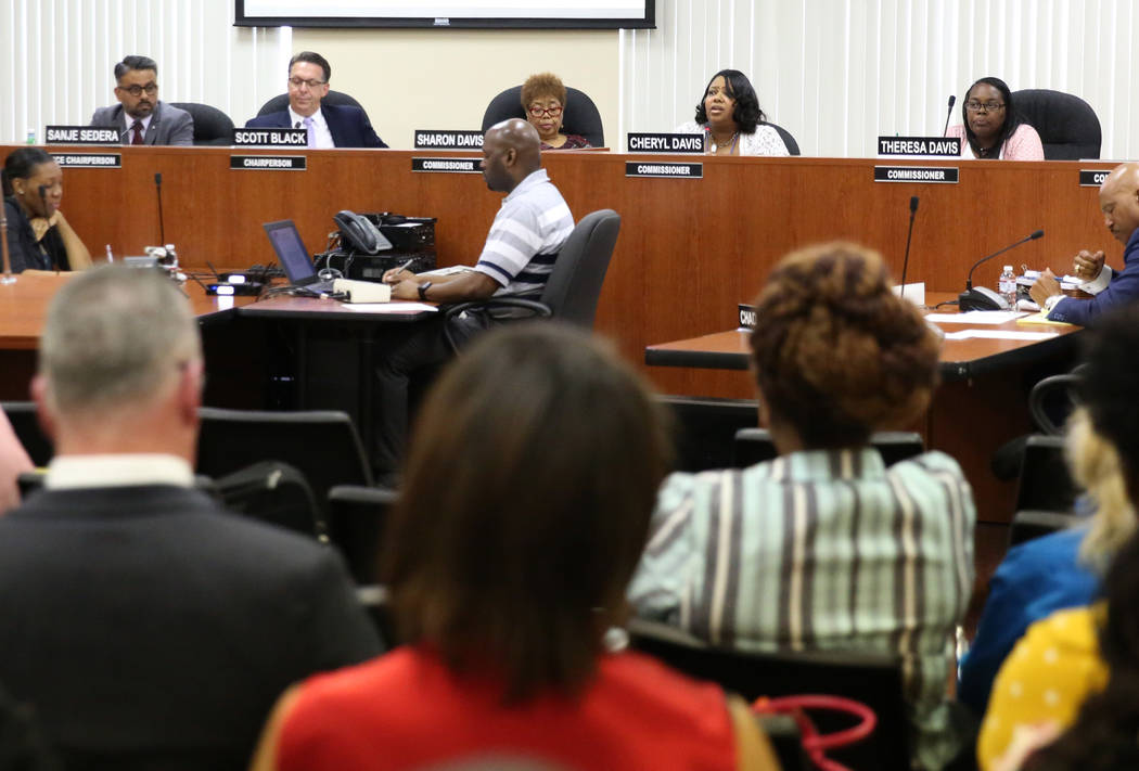 Southern Nevada Regional Housing Authority Resident Commissioner Cheryl Davis, second right, sp ...