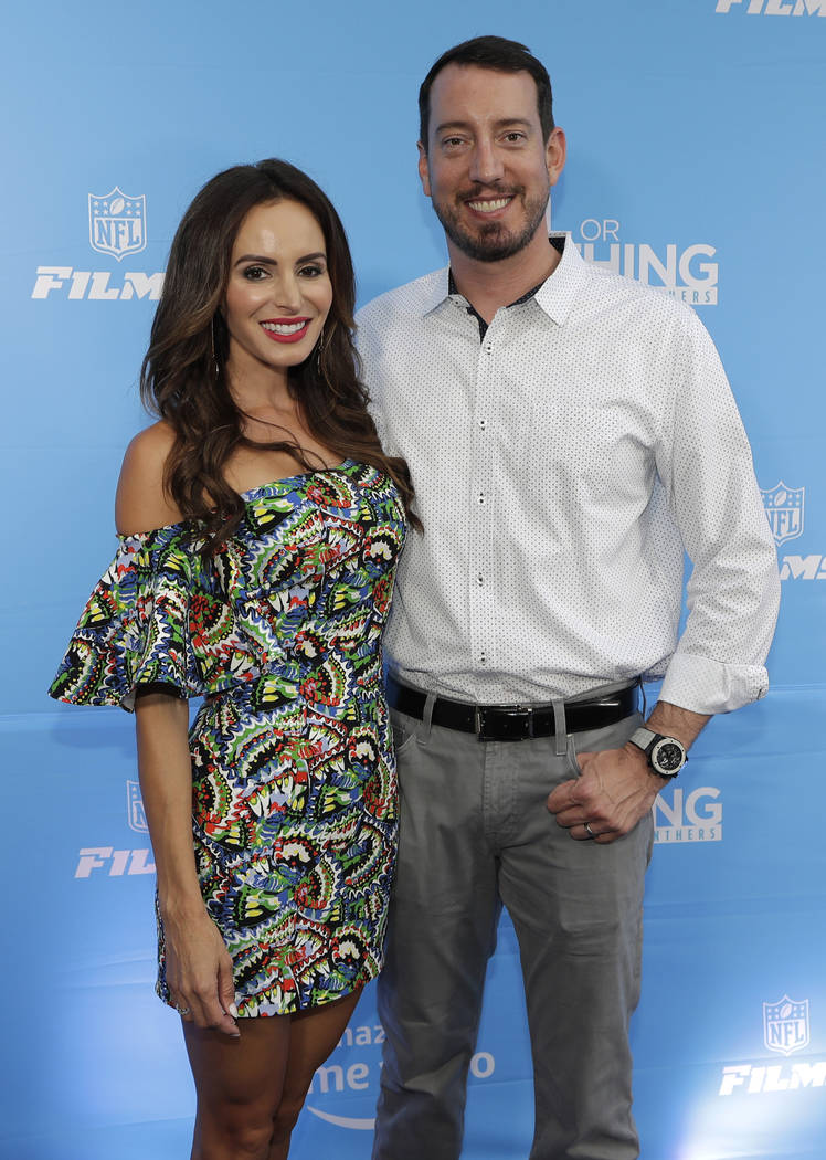 NASCAR driver Kyle Busch, right, poses for a photo with his wife, Samantha, as they arrive befo ...