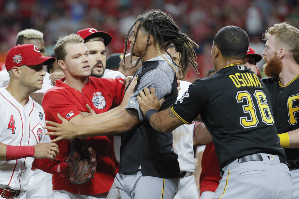 Pittsburgh Pirates starting pitcher Chris Archer, center is restrained during a bench-clearing ...