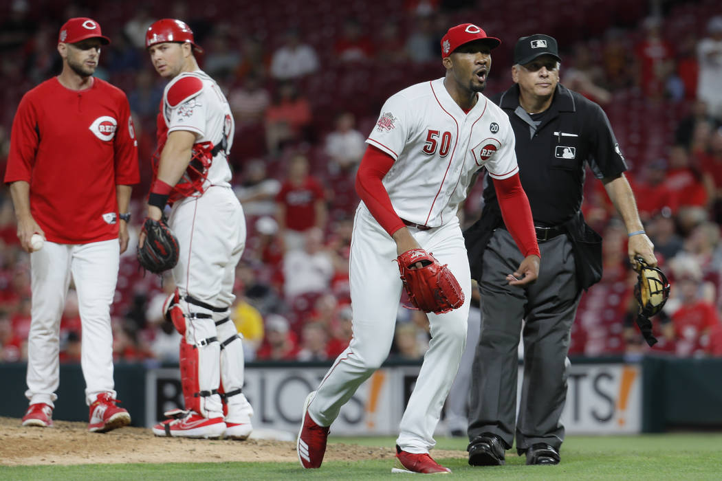 Cincinnati Reds relief pitcher Amir Garrett (50) charges the Pittsburgh Pirates bench in the ni ...