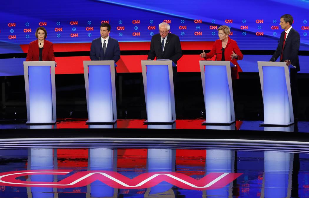 From left, Sen. Amy Klobuchar, D-Minn., South Bend Mayor Pete Buttigieg, Sen. Bernie Sanders, I ...