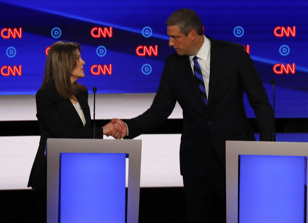 Marianne Williamson and Rep. Tim Ryan, D-Ohio, shake hands after the first of two Democratic pr ...