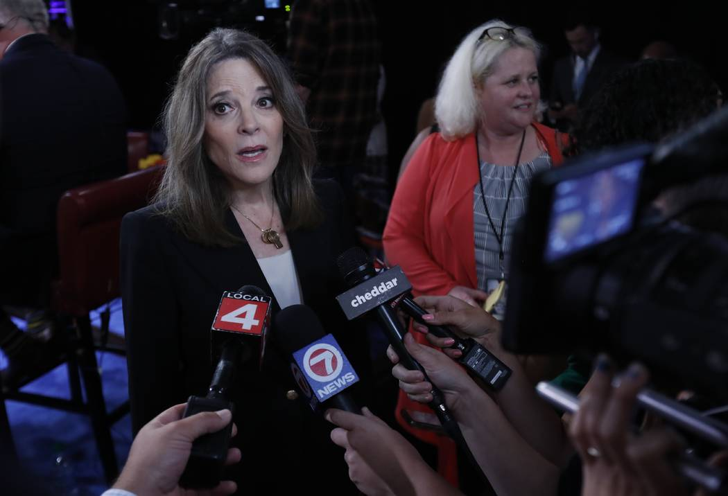 Marianne Williamson talks to reporters after the first of two Democratic presidential primary d ...
