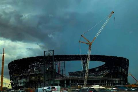 Storm clouds form behind construction of the Las Vegas Stadium in Las Vegas, Wednesday, July 31 ...