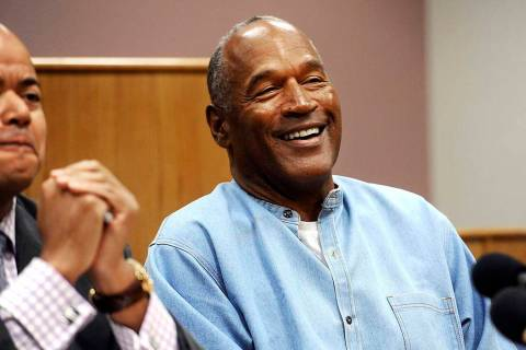 In this July 20, 2017, file photo, former NFL football star O.J. Simpson reacts after learning ...