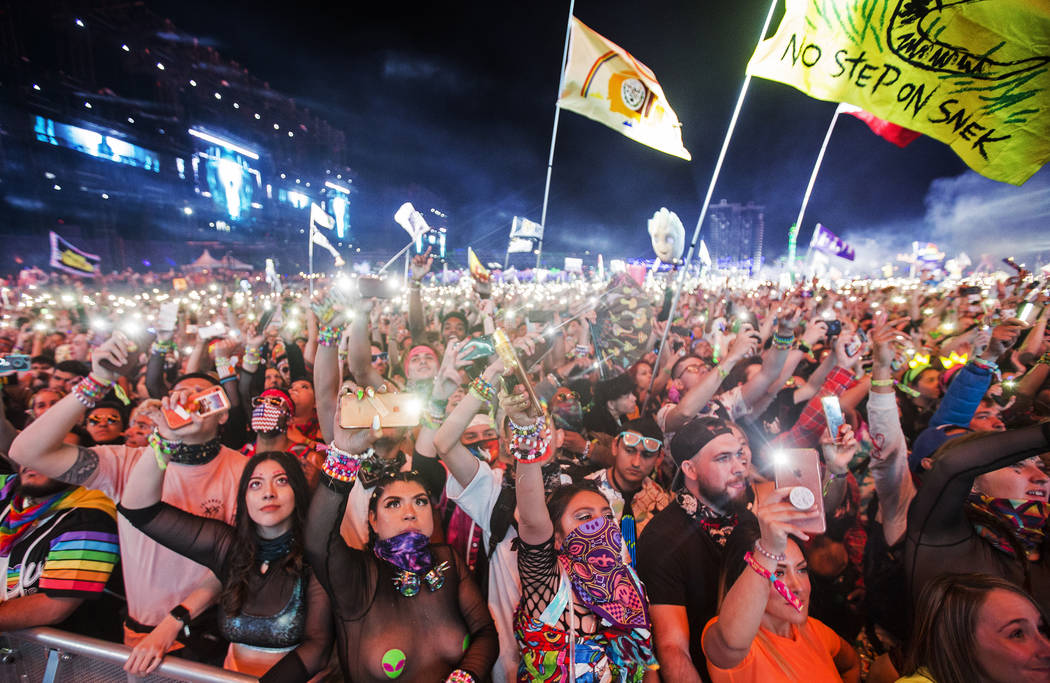 A sea of concert goers dance during SAYMYNAME's performance at the Circuit Grounds stage on day ...