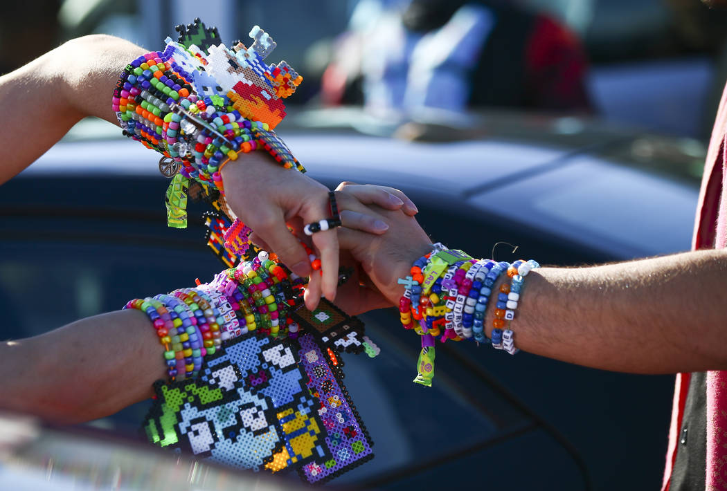 Alex Spry, of Moreno Valley, Calif., left, trades kandi with Esteban Hernandez, of N. J., as El ...