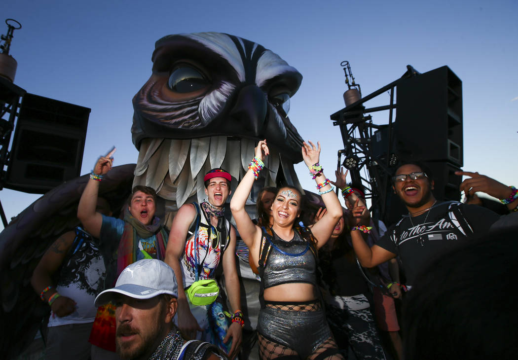 Attendees dance at the Wide Awake art car during the first day of the Electric Daisy Carnival a ...