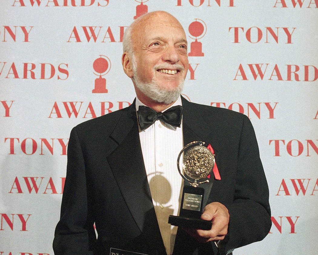 FILE - In this June 4, 1995 file photo, Harold Prince holds his Tony award for best director in ...