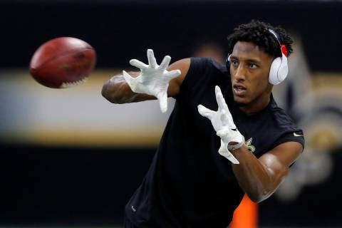 New Orleans Saints' Michael Thomas warms up before the NFL football NFC championship game again ...