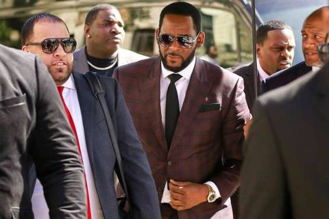 In a June 26, 2019, file photo, R&B singer R. Kelly, center, arrives at the Leighton Criminal C ...