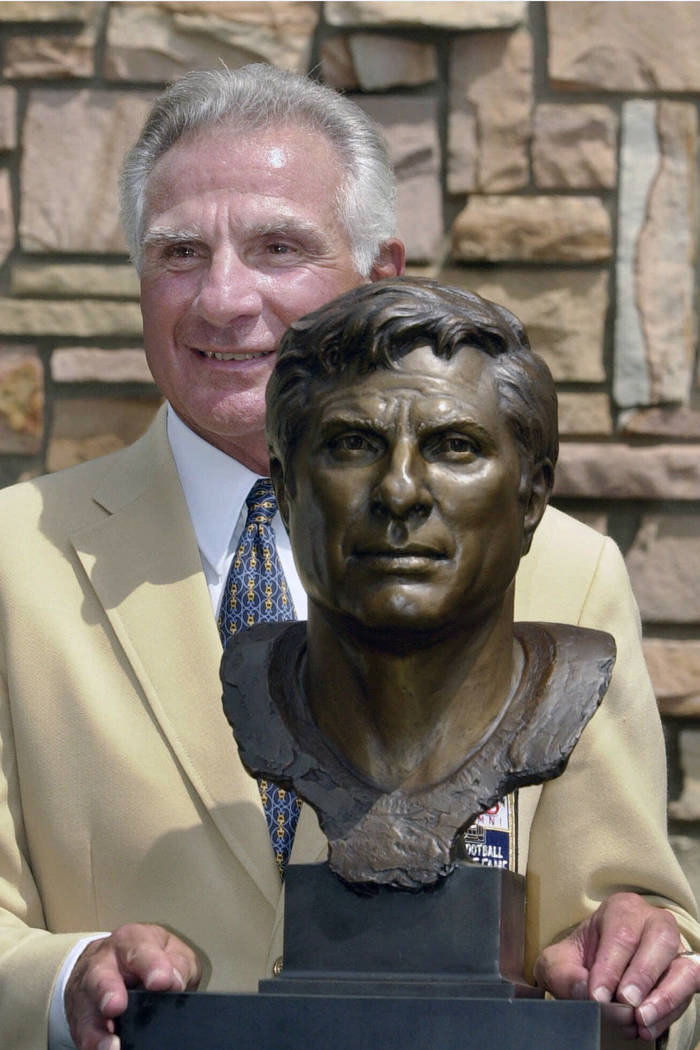 FILE - In this Aug. 4, 2001, file photo, former Miami Dolphins great Nick Buoniconti holds his ...