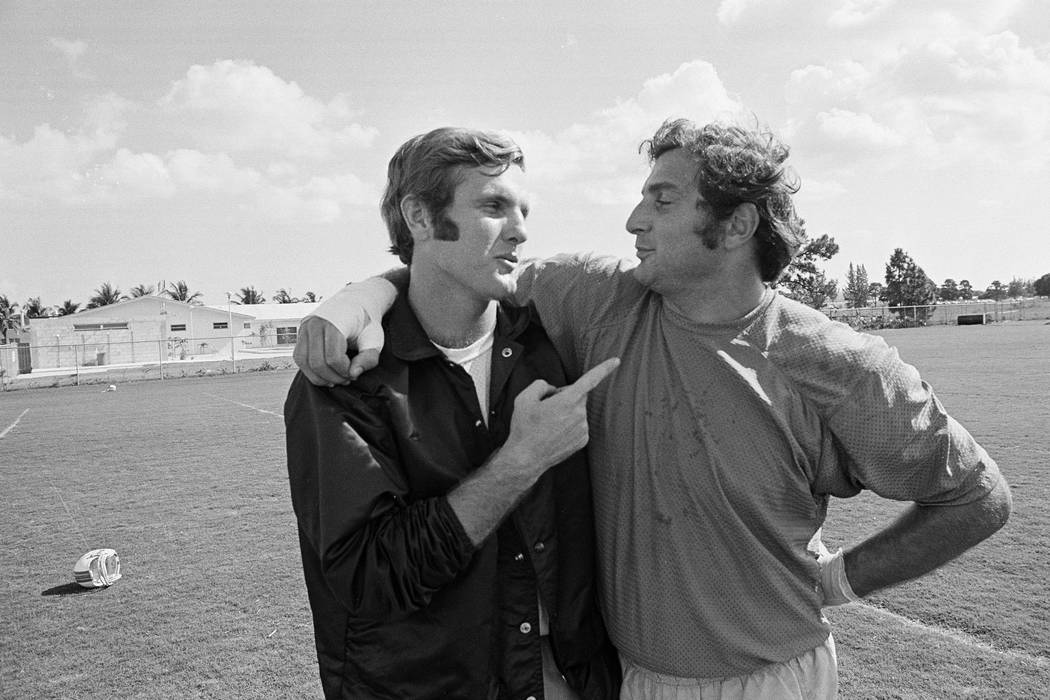 FILE - In this Jan. 5, 1972, file photo, Miami quarterback Bob Griese, left, and linebacker Nic ...