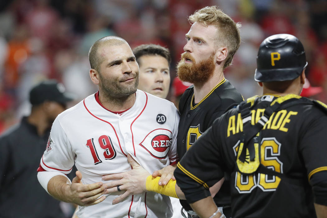 Cincinnati Reds first baseman Joey Votto (19) is restrained by Pittsburgh Pirates third baseman ...