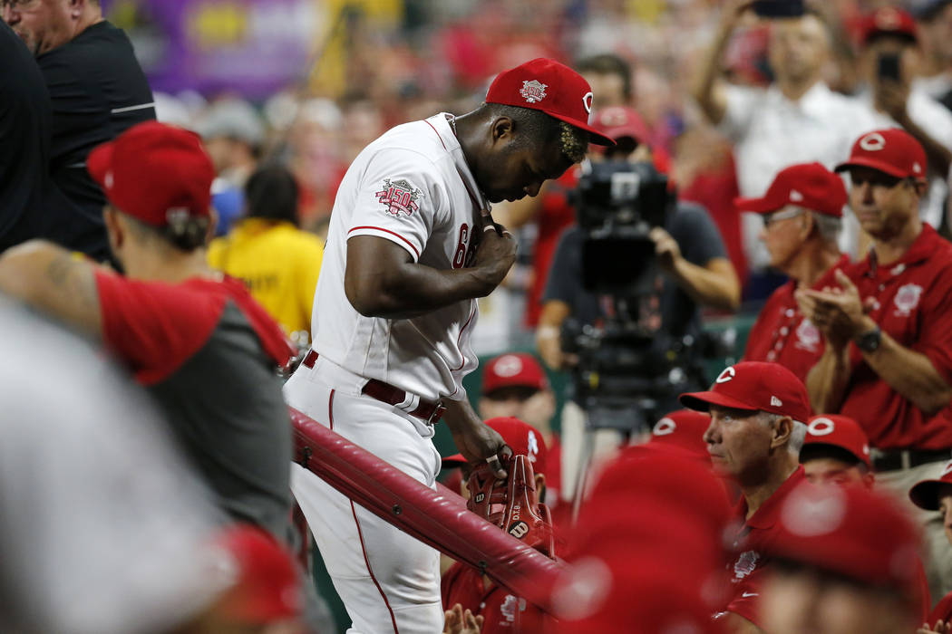 Cincinnati Reds right fielder Yasiel Puig leaves the field at the end of the top of the ninth i ...