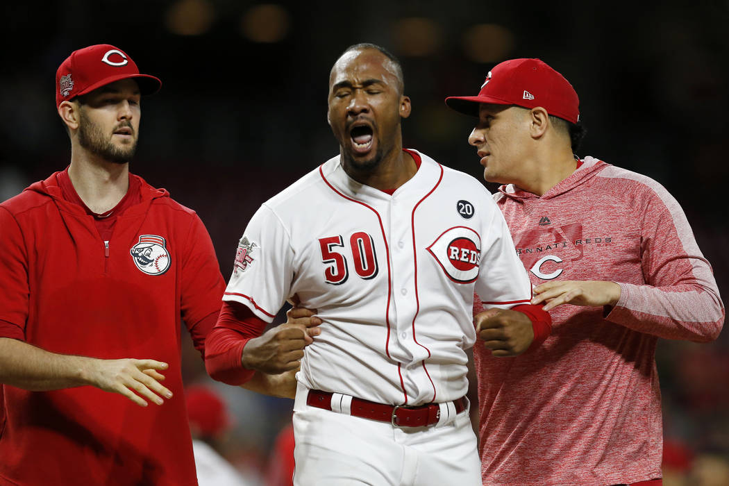 Cincinnati Reds relief pitcher Amir Garrett (50) is pulled away as the Reds and Pittsburgh Pira ...
