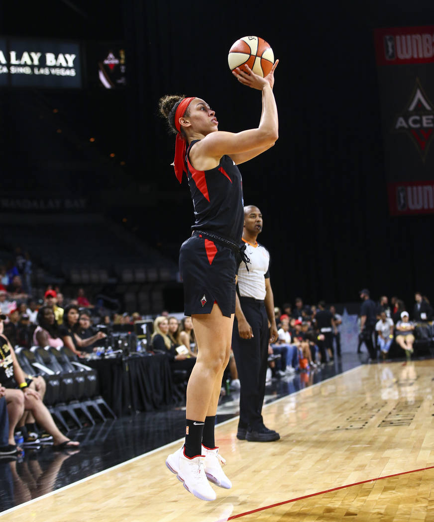 Las Vegas Aces' Dearica Hamby (5) shoots against the Dallas Wings during the first half of a WN ...