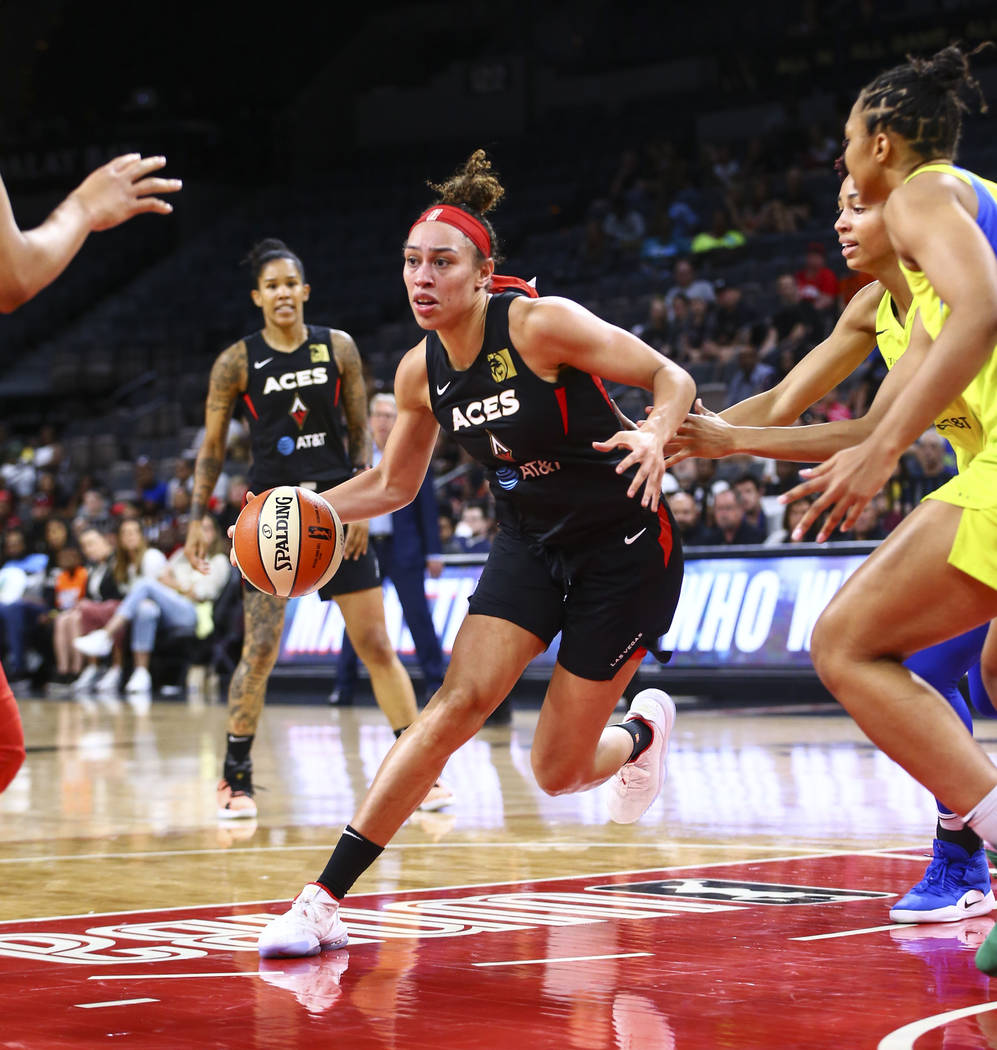 Las Vegas Aces' Dearica Hamby drives to the basket against the Dallas Wings during the first ha ...