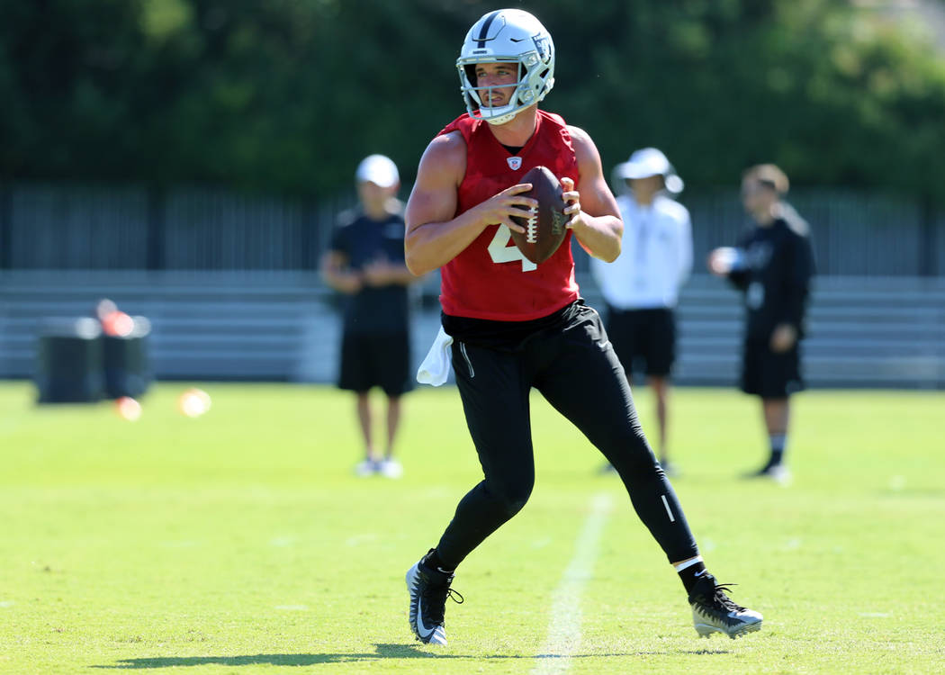 Oakland Raiders quarterback Derek Carr (4) drops back to pass during the NFL team's training ca ...