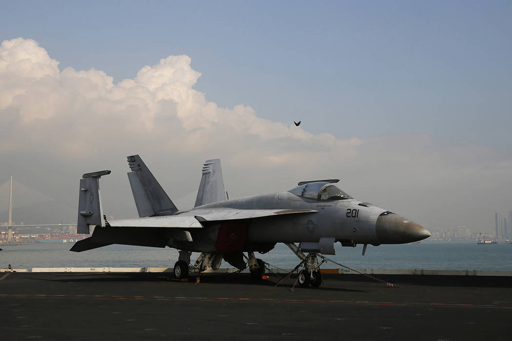 An F/A-18 Super Hornet fighter jet is seen on the deck of the U.S. Navy USS Ronald Reagan aircr ...