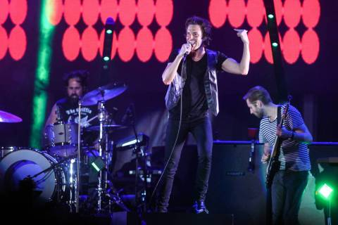 Brandon Flowers performs with The Killers during a surprise appearance at the Life is Beautiful ...