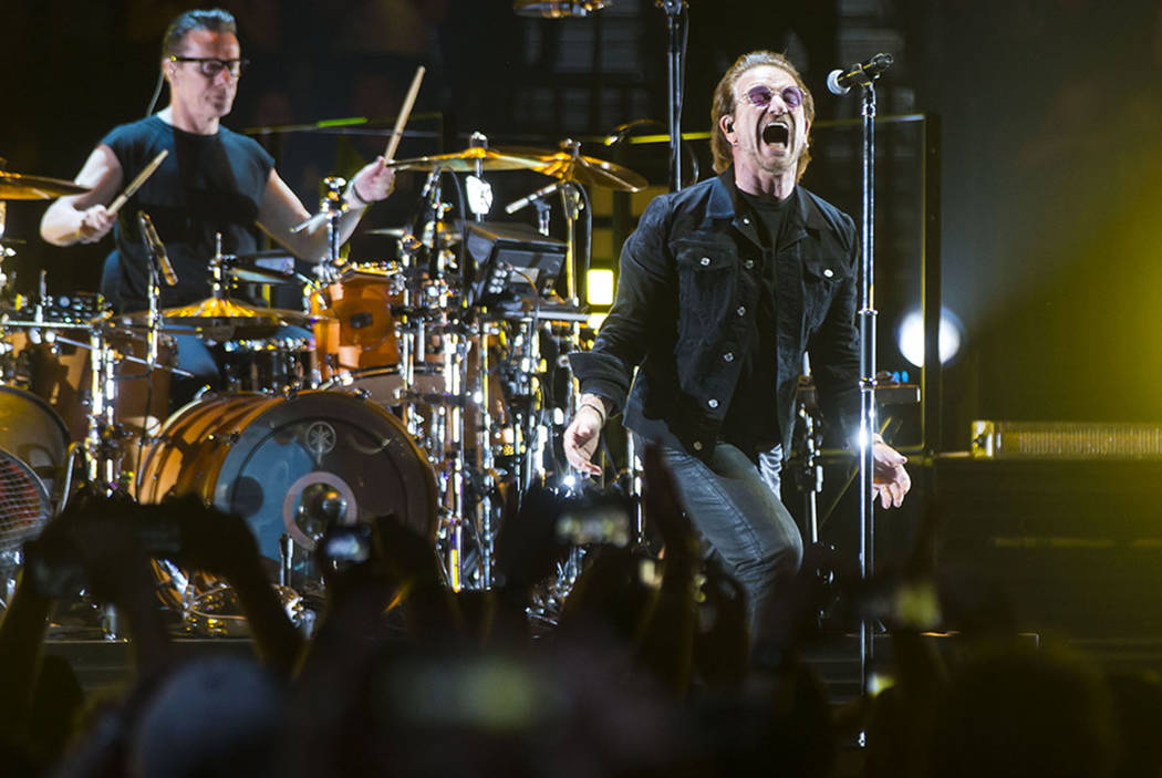 Larry Mullen Jr., left, and Bono of U2 perform at T-Mobile Arena in Las Vegas on Friday, May 11 ...