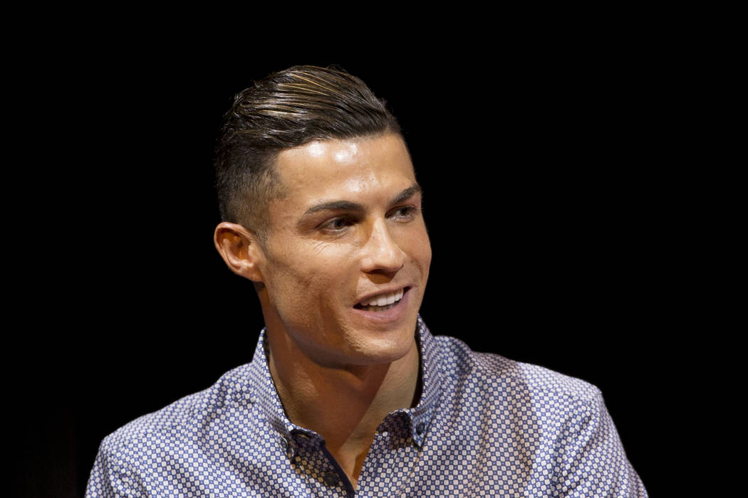 Juventus soccer player Cristiano Ronaldo speaks after receiving the Lifetime Achievement award ...