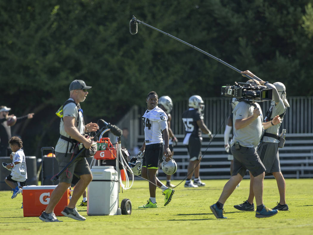 Oakland Raiders wide receiver Antonio Brown (84) walks on the sideline as an HBO Hard Knocks cr ...