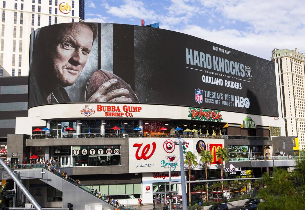 A digital billboard displays Oakland Raiders coach Jon Gruden in an advertisement for the upcom ...