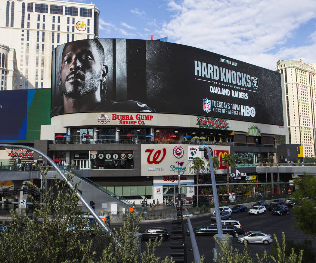 A digital billboard displays Oakland Raiders' Antonio Brown in an advertisement for the upcomin ...