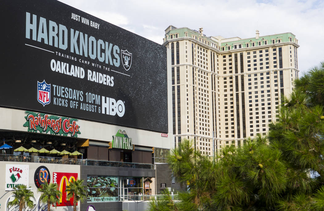 """A digital billboard displays an advertisement for the upcoming season of """"Hard Knocks&quot ..."""