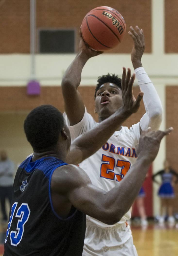 Bishop Gorman junior forward Mwani Wilkinson (23) shoots a jump shot over Desert Pines junior D ...