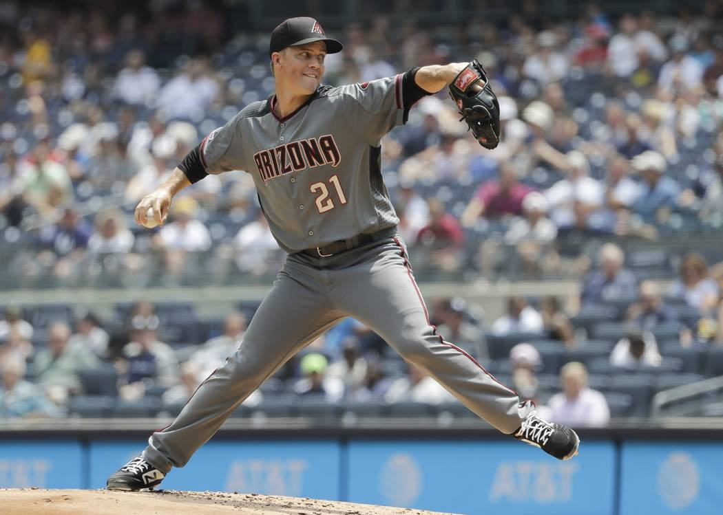 Arizona Diamondbacks' Zack Greinke delivers a pitch during the first inning of a baseball game ...
