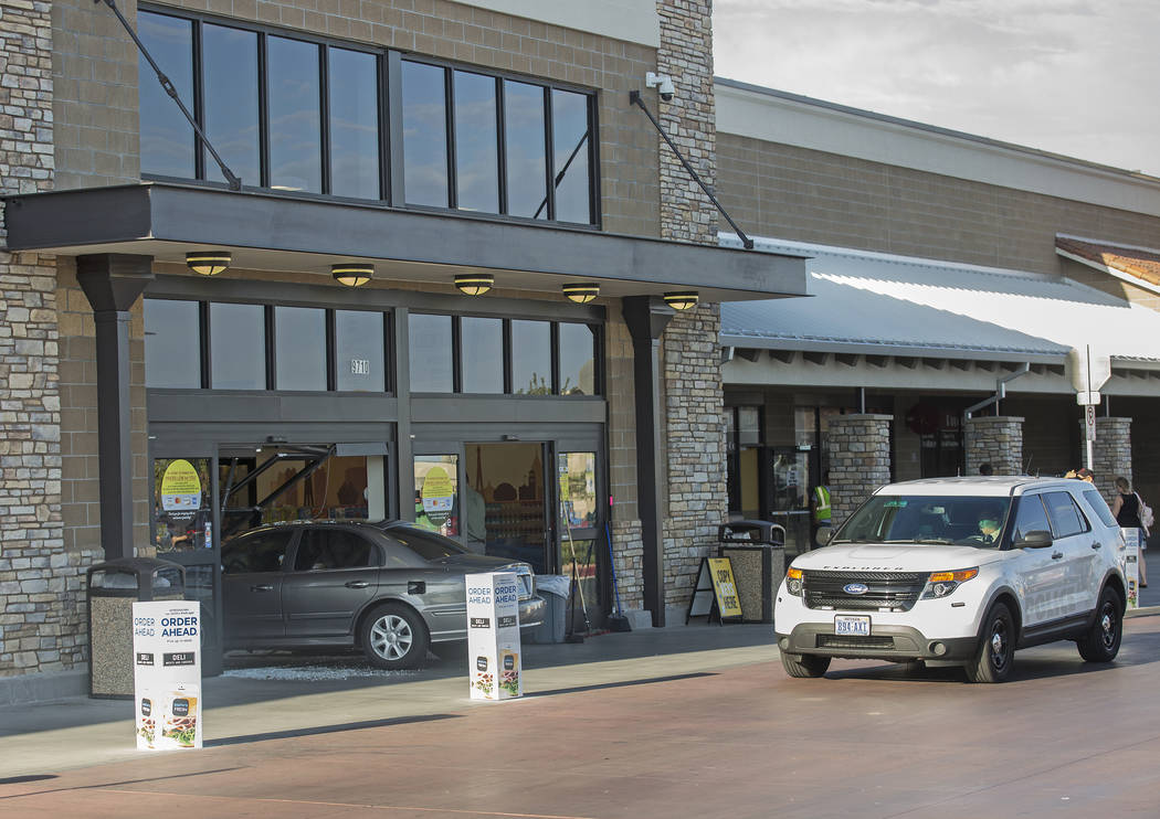 A car crashes into the Smith's Marketplace, at 9710 West Skye Canyon Park Drive, Wednesday, Jul ...