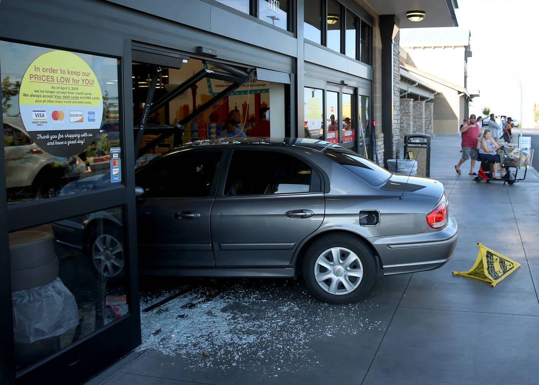 A car crashes through the main entrance of the Smith's Marketplace in Skye Canyon in Las Vegas, ...