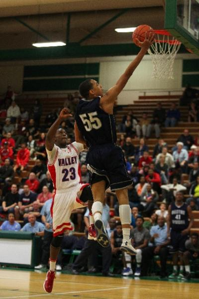 Canyon Springs guard Jordan Davis soars to the basket past Valley guard Nick Brannon in the ...