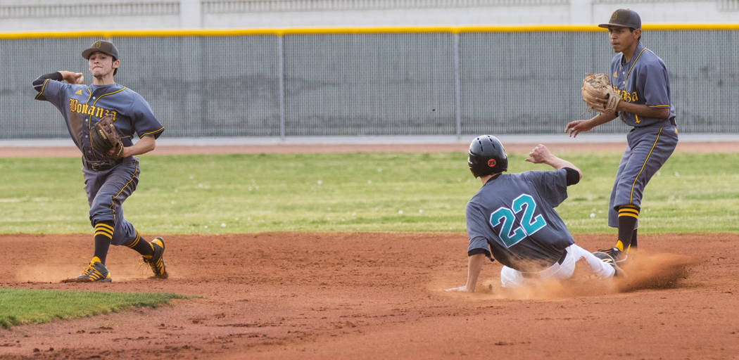Silverado pitcher Tyler Paasche (22) slides into second base in the second inning during a b ...