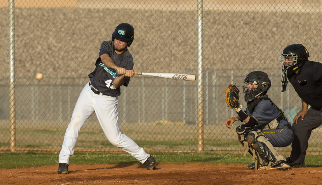 Silverado first baseman Michael Janosik (42) hits the ball in the fifth inning during a base ...