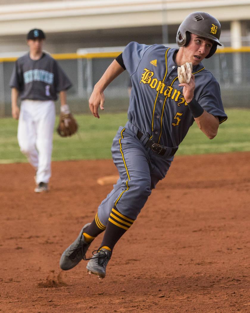 Bonanza second baseman Matthew Cox (5) runs for third base in the fifth inning during a base ...