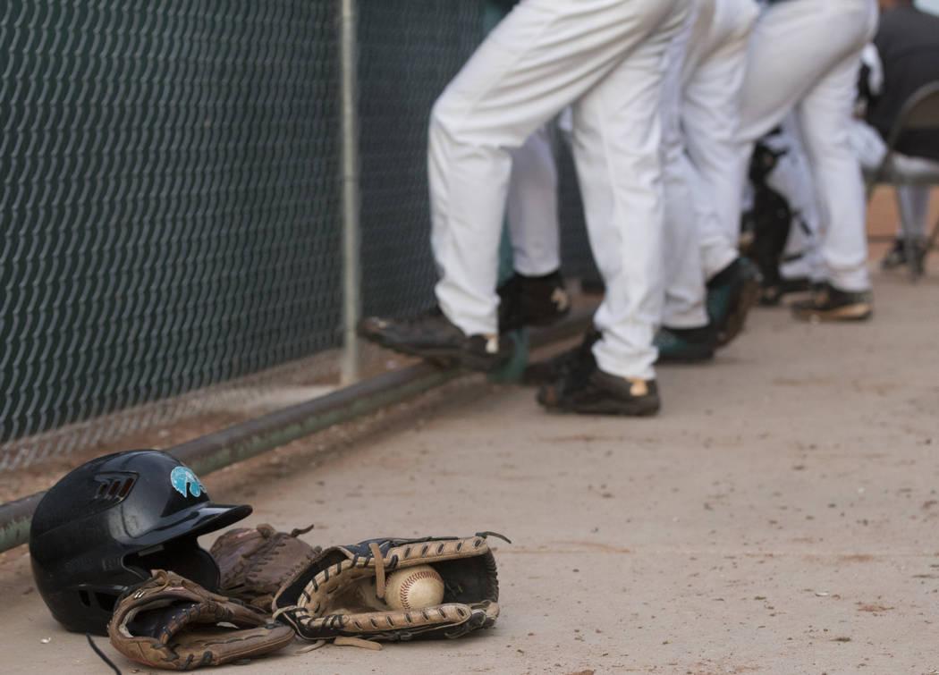 The Silverado High School baseball team waits in the dugout during a baseball game against B ...